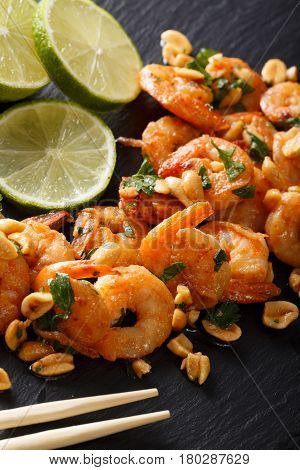 Spicy Sauteed Of Shrimp, Peanuts, Lime And Herbs Closeup. Vertical
