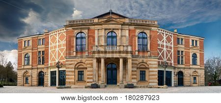 Wagner Festival Theatre in Bayreuth at daylight near sunset poster
