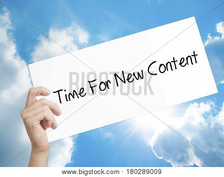 Man Hand Holding Paper With Text Time For New Content . Sign On White Paper. Isolated On Sky Backgro