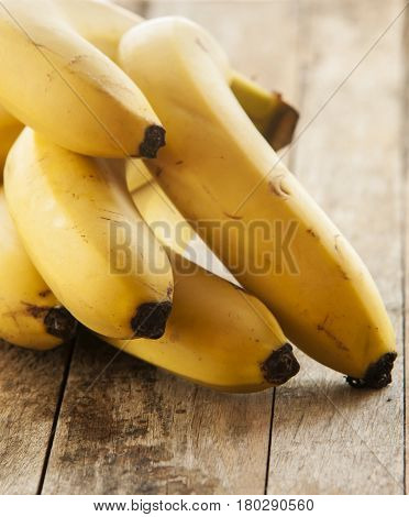 banana bunch on Wooden background close up
