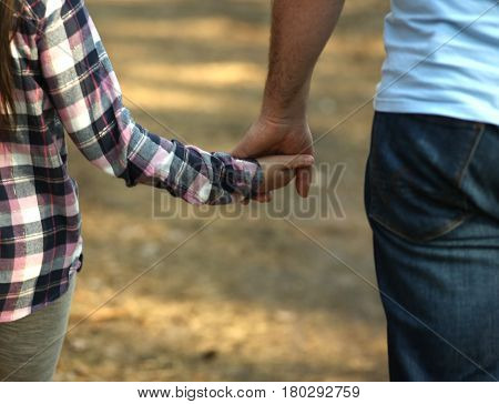 The parent holds the hand of a child. Fathers day