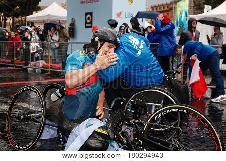Rome Italy - April 2nd 2017: Alex Zanardi is the winner of the hand bike race of the 23rd Rome Marathon. Zanardi arrival at the finish line receives a warm hug.