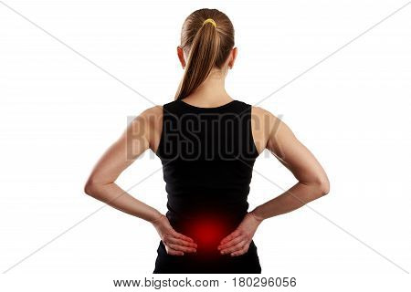 Fitness woman suffering from lumbar pain over white.