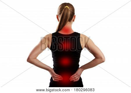 Rear view of young female having spine pain shown with red dots.