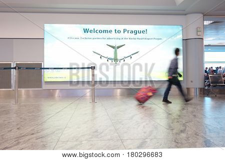 PRAGUECZECH REPUBLIC - 10-03-2016: A man walks down the concourse at Vaclav Havel International Airport in Prague