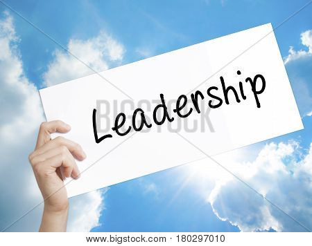 Man Hand Holding Paper With Text Leadership . Sign On White Paper. Isolated On Sky Background