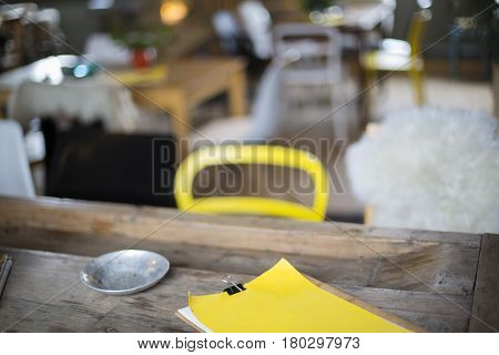 Yellow Clipboard On A Nice Concept Table With Vintage Cutlery