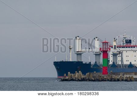 MERCHANT VESSEL - Cargo ship and angler on the breakwater