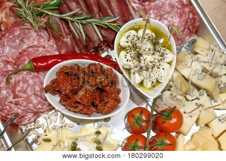 Nice Mediterranean Appetizers Plating With Salami, Pastrami And Cheese Close Up