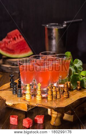 A water-melon and basilic set with vodka, lemon juice, syrup of a water-melon and a basil