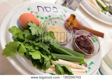 seder plate vor passover holiday and special napkin with embroidery for matze bread knew plate located below