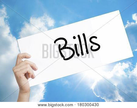 Man Hand Holding Paper With Text Bills . Sign On White Paper. Isolated On Sky Background