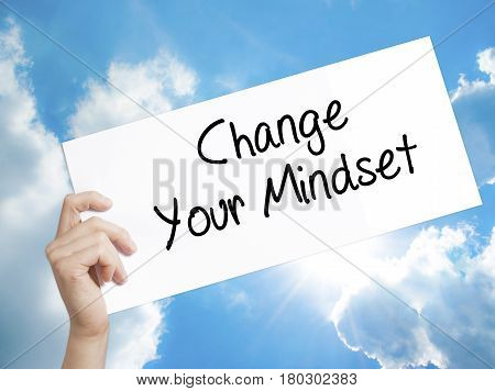 Man Hand Holding Paper With Text Change Your Mindset . Sign On White Paper. Isolated On Sky Backgrou