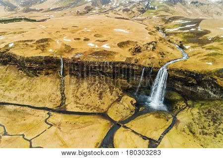Aerial View Of Famous Seljalandsfoss Is One Of The Most Beautiful Waterfalls On The Iceland. It Is L