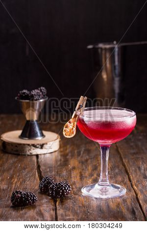 Cocktail with gin, blackberry liqueur, lemon juice and sugar syrup