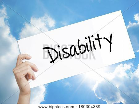 Man Hand Holding Paper With Text Disability . Sign On White Paper. Isolated On Sky Background
