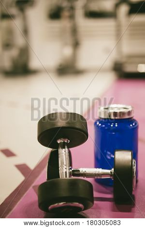 Weight And Whey Protein Supplement In The Gym