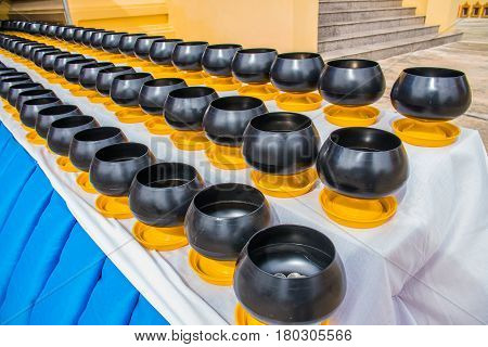 Buddhist monk's alms bowl for make a merit by putting coins