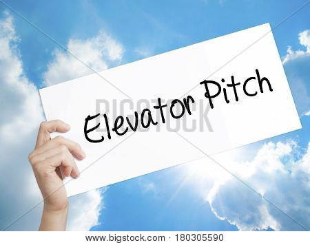 Man Hand Holding Paper With Text Elevator Pitch . Sign On White Paper. Isolated On Sky Background