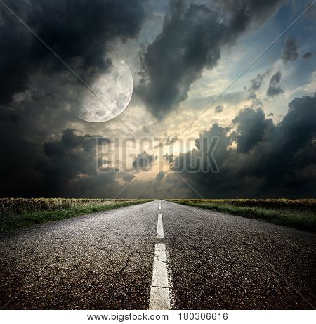 Highway and the moon. Elements of this image furnished by NASA