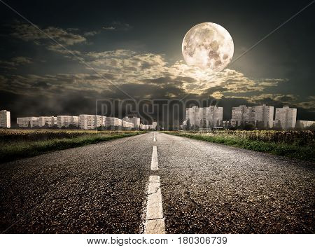 Highway to district under the moon. Elements of this image furnished by NASA