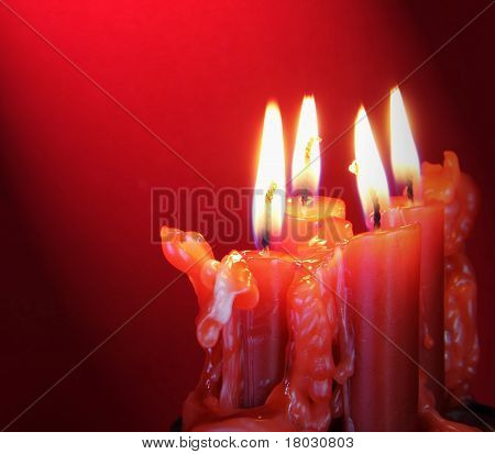 Burning Candles With Light Directed On Them