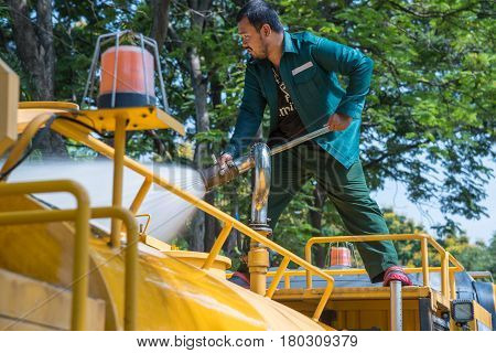 Watering The Lawn By Water Tanker Truck