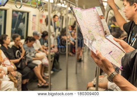 Mrt Subway Train, Tourist Looks Location On Map