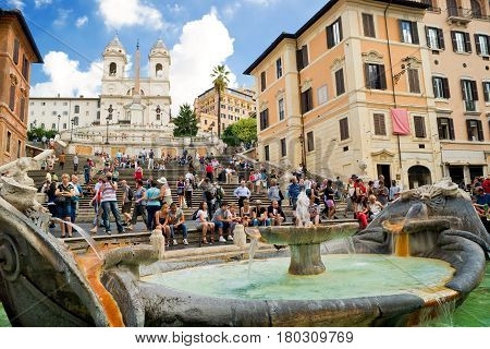 ROME - CIRCA OCTOBER 2012: The Spanish Steps seen from Piazza di Spagna with Fountain Fontana della Barcaccia.The Spanish Steps are the widest staircase in Europe.