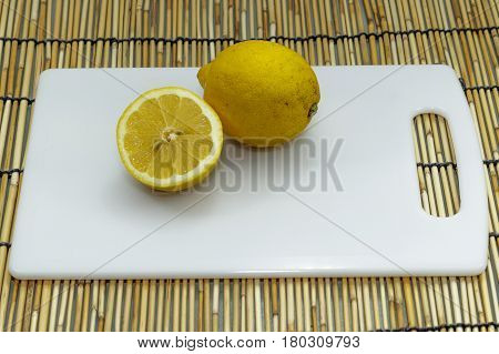 Lemon slices on a plate.Lemons contain more potassium than apples or grapes. Potassium is beneficial to the heart.
