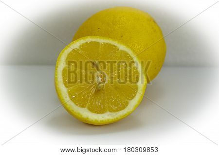 Close up of lemon slices on a plate.Lemons contain more potassium than apples or grapes. Potassium is beneficial to the heart.