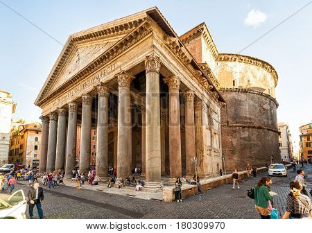 ROME - OCTOBER 2, 2012: Tourists visit the Pantheon. Pantheon is a famous monument of ancient Roman culture the temple of all the gods built in the 2nd century.