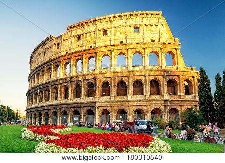 ROME - OCTOBER 4, 2012: The Colosseum (Coliseum) at sunset. The Colosseum is a major tourist attraction in Rome.