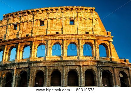 Colosseum (Coliseum) at sunset in Rome, Italy