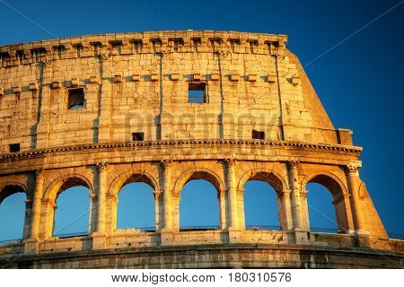 Colosseum (Coliseum) in Rome during sunset, Italy
