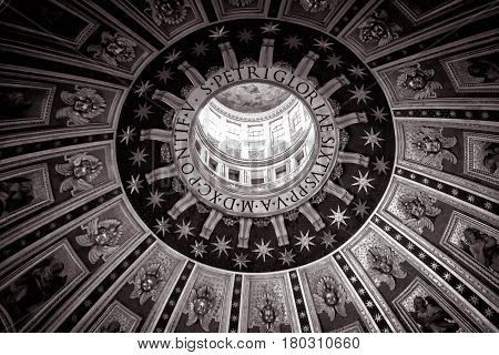 ROME - MAY 12, 2014: Interior of Saint Peter's Basilica. The central dome. St. Peter's Basilica (San Pietro) is one of the main tourist attractions of Rome and Vatican.