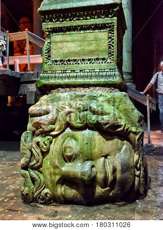 ISTANBUL - MAY 25, 2013: The head of Medusa in the Basilica Cistern. It is the largest of several hundred ancient cisterns that lie beneath the city of Istanbul (formerly Constantinople).