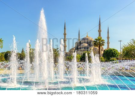 View of the Blue Mosque (Sultanahmet Camii) with fountain in Istanbul, Turkey