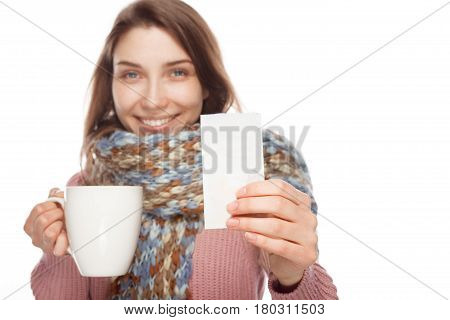 Young woman looking after taking medicament and showing mug and prescription on white background
