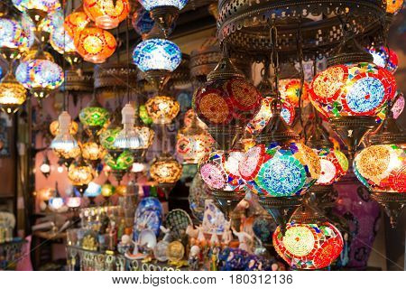 ISTANBUL - MAY 27, 2013: Colorful Turkish lanterns offered for sale at the Grand Bazaar in Istanbul, Turkey. It is a popular souvenir for tourists.