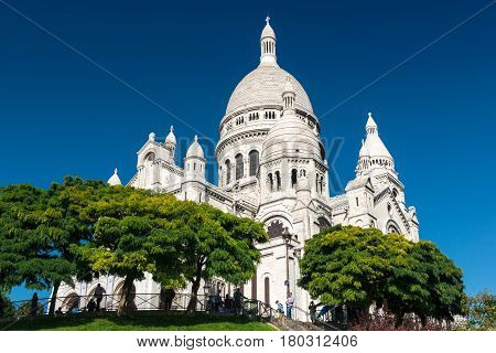 PARIS - SEPTEMBER 24: Tourists visiting the Basilica of the Sacred Heart(Basilique du Sacre-Coeur) on september 24, 2013. A popular landmark the basilica is located at the summit of the butte Montmartre the highest point in the city.
