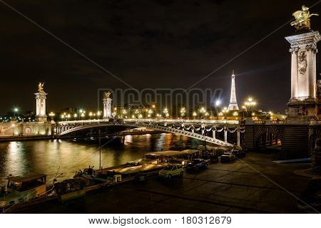 The Pont Alexandre III at night in Paris, France. This bridge was named after russian Tsar Alexander III.