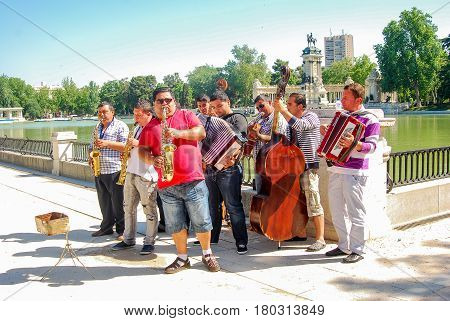 Madrid,Spain-May 13,2011: Group of street musicians play in El Retiro park in Madrid in a sunny spring day
