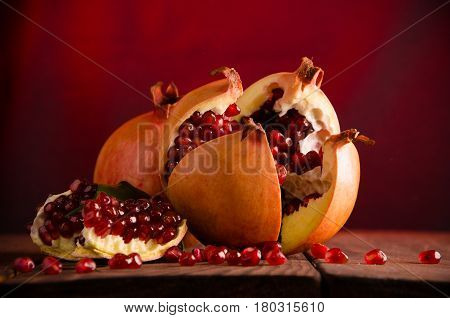 The Pomegranate Is Ripe. Cut Into Pieces Of Ripe Pomegranate. On Wooden Boards.