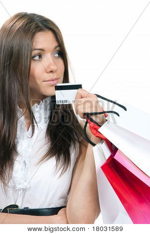Woman Standing, Holding Credit Card And Shopping Bags In Hand