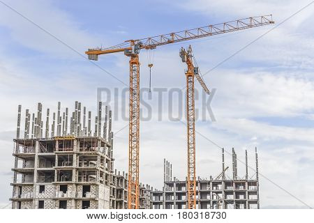 Hoisting cranes and building of new apartments