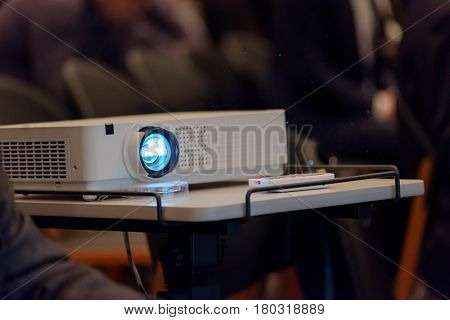 Projector demonstrates the presentation at the conference