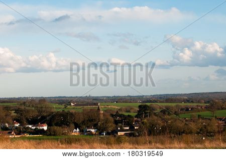 English Village Viewed From A Countryside Filed