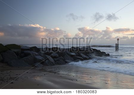 Early sunrise on Southwold Beach Suffolk England