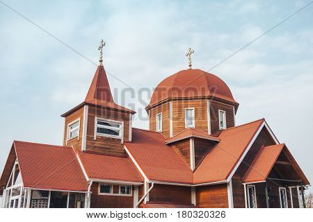 the roof dome and cross of an old wooden Church.